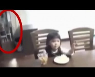 Scary!!! Daughter see her father standing behind the camera……
